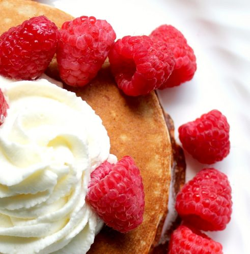 Top pancakes with a circle of raspberries and a large spoonful of whipped cream. If liked, sprinkle caster sugar and serve with real dairy cream.