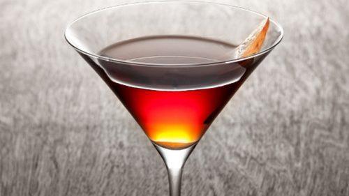 Garnish with orange slice and cherry.